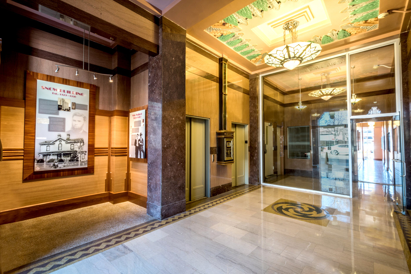 The Snow Building Lobby w Historical Exhibit and Lighting - hem and spire llc